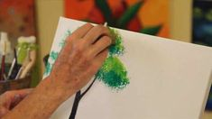 Learn how to paint trees using acrylic paint from painter Linda Rhea in this Howcast video.