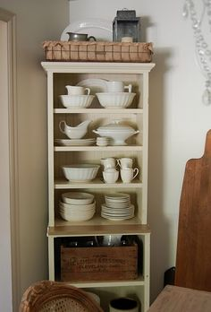 great small china cabinet with vintage pieces to accent