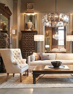 A small simple mirror hanging sooo high up the wall, vertical to a huuuuge antique decorated mirror! The light fixture on the wall is absolutely exquisite!!! More