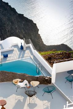 Luxury Grace Hotel Design with Dramatic Landscape:Blue Outdoor Chairs And Simple Coffee Table In Hotel Deck