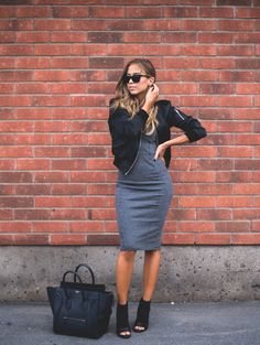 Grey Knee-Length Dress with Bodice Stitching paired with a Black Bomber Jacket and Peep-Toe Black Booties
