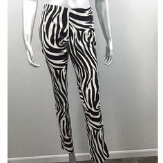 "Michael -Michael Kors Black & White Zebra Pant Sexy Black & White Animal Print.  Ankle Length. 97% Cotton 3% Spandex.  Side zipper. Waist 26"" Inseam 28.5"" Length 37.5"" Leg opening 6.25"" Side Hem Vent 1"" Front Rise 8.5"" Back Rise 11.5"" MICHAEL Michael Kors Pants Ankle & Cropped"