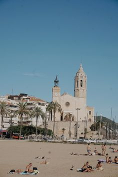 Pictures What to do in Sitges Spain Photography Travel, Sitges Church Sant Bartomeu i Santa Tecla & beachgoers. Barcelona Spain Travel, Barcelona Beach, Sitges, Vacation Places, Places To Travel, Disney Vacations, Beach Photography, Travel Photography, Germany In Winter