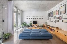 Pared-back in its design, the house features simple elements such as nude concrete floors and white-painted exposed brick walls in place of traditional materials like plaster and polystyrene, which also keep the house cool.