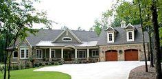 Stone exterior  Color scheme  metal roof  wood garage doors