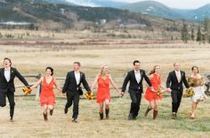 It snowed on this Colorado Wedding Party - but they seemed to be having a blast with the photos! See the wedding here: http://www.StyleMePretty.com/2014/05/20/rustic-devils-thumb-ranch-wedding/  Photography: JacAndHeath.com