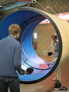 Tube tennis or circular ping pong cool. I have a ping pong table but not like this!