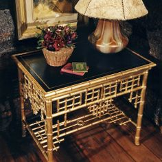 Indian Cove Lodge Chinoiserie end table with bamboo form and bookbinder's leather insert, by Ralph Lauren.