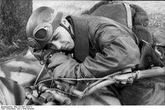 German paratrooper sleeping on his motorbike.France  21 June 1944