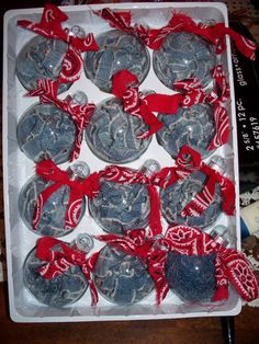 I bought the glass ornaments for $2.00 stuffed them with denim, and tide ripped up handkerchief! Good x-mas idea!