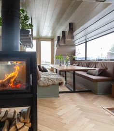 The see-through wood burner lets you enjoy the 🔥 from the lounge area as well as the dining area. Our marine cabin is your perfect getaway and can also be rented for meetings and dinner parties with your very own private 'chef-on-board'. Decor, Home Appliances, Holiday Home, House, Home, New Homes, House Interior, Lounge Areas, Interior Design