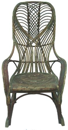 Mid 20th century twig rocking chair, with tall circular back with a heart design, and down swept arms