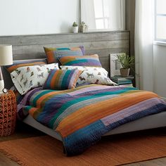 Spectrum Quilt and Sham in a sophisticated spectrum that ranges from navy, teal and gray to violet, bright orange and avocado