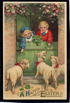 Children feeding lambs at Easter