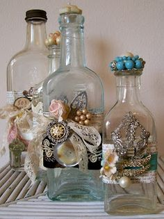 I like these. To take it further, the idea would be to get bottles in the wedding colors, and embellish them.