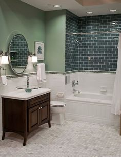 Green color on wall is pretty and I like the mirror.  I think that the tile color is too dark.