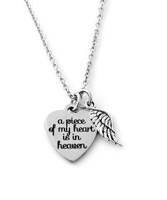 With a petite angel's wing floating beside it, this necklace's heart-shaped pendant offers a sweet remembrance of someone special.