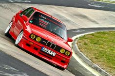 BMW E30 M3 red on the ring