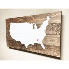 This Rustic Wooden World Map is a unique piece for your home or office! White vinyl USA map is sealed onto a rustic wood base and a red heart