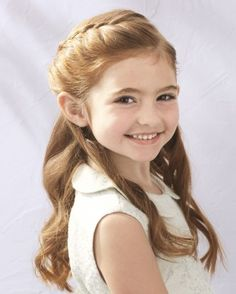 """See the """"Braided Half-Up-Half-Down Hairstyle"""" in our Flower Girl Hairstyles That Are Cute and Comfy gallery"""