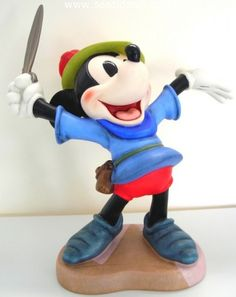 """Mickey Mouse, WDCC Walt Disney Classics Collection. From the cartoon classic (Brave Little Tailor), porcelain figurine is 7 1/4″ tall. """"I Let 'em Have It"""" is retired. $185."""