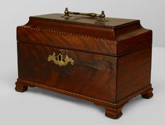English Georgian Mahogany Tea Caddy Box On Bracket Feet With Inlaid Satinwood And Ebony Banding And A Hinged Stepped Up Top With A Brass Handle And Escutcheon