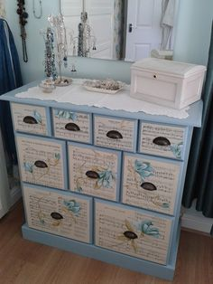 Decoupaged chest of drawers. With sheet music and flowers cut from wallpaper.