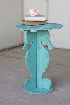 This is such a cute seahorse table. I could see it out on our lanai in FL.