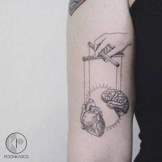 Surrealist puppet tattoo on the right bicep. Tattoo artist:...