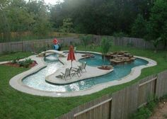 Garden and Patio, Small Backyard Lazy River Pool With Lounge Area In The Middle Plus Stone Waterfall Surrounded By Green Grass And Wooden Fence Ideas ~ Backyard Lazy River Lazy River Pool, Backyard Lazy River, Backyard Paradise, Nice Backyard, Large Backyard, Backyard Ideas Kids, Backyard Stream, Backyard Barn, Camping Ideas