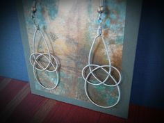 Up-cycled Electric Guitar String Earrings. $20.00, via Etsy.