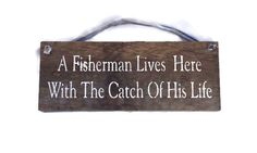 A Fisherman Lives Here With The Catch Of His Life - Barn Wood Sign - Fishermen Gifts - Fly Fishing - Fishing Decor - Outdoor Fishing Sign by Montanacreatives on Etsy https://www.etsy.com/listing/468008353/a-fisherman-lives-here-with-the-catch-of