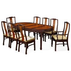 "This Ming (1368-1644) style dining table set is crafted from solid rosewood using traditional joinery techniques. The table can be extended to 80"" with two 18"" removable leaves. Its elegant natural rosewood finish with mahogany trim rounds out its quiet beauty. The set comes with six side chairs and two armchairs."
