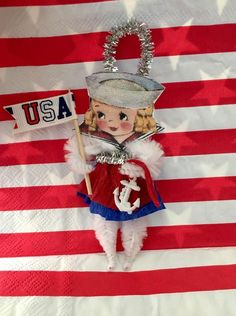 Cute retro Patriotic of July Girl, Sailor girl. This cute ornament was made with old new stock chenille stems. and vintage accessories. Can be used as ornament, party favor, cake decoration,scrapbook or card embellishment. 4th July Crafts, Fourth Of July Decor, Patriotic Crafts, Patriotic Decorations, July 4th, Pipe Cleaner Crafts, Pipe Cleaners, Independence Day Decoration, Patriotic Images