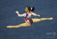 Japan's Asuka Teramoto performs on the floor during the women's all-around final at the Gymnastics World Championships in Nanning, in China's southern Guangxi province on October 10, 2014.(c)AFP/Greg BAKER ▼13Oct2014AFP|【写真特集】カメラがとらえた世界体操のワンシーン http://www.afpbb.com/articles/-/3028472 #寺本明日香 #Asuka_Teramoto