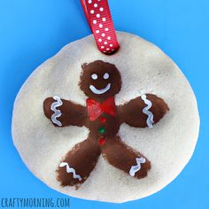 Learn how to make a salt dough fingerprint snowman ornament with your kids! It's a fun Christmas craft to do with the kids for gifts.