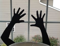 Fill your windows with spooky images to create a DIY haunted house! (Those are my son's hands that I traced).   -- more on the blog!