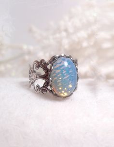 Blue Opal Ring. never even knew there was such thing as a blue opal and opal is one of my favorite stones!