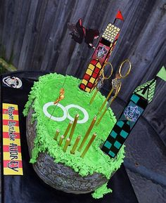 Harry Potter Qudditch cake with Gryffindor and Slytherin towers, plus a flying Gryffindor witch trying to catch the Golden snitch! Such a fun cake to make!
