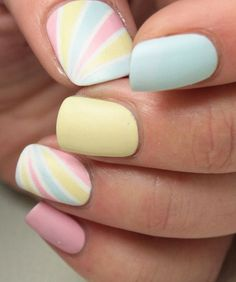 Lovely pastel side swiped striped accent nails with alternating solid pastel nails #nailart