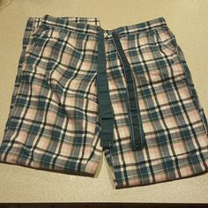 Plaid Aerie Pj bottom Pink and blue plaid Pj Bottoms from Aerie. Bottoms can be rolled to show a blue striped pattern and buttoned into place on the sides (shown in second and fourth pics) in perfect condition. Top has pockets and a drawstring. Size xs. aerie Other