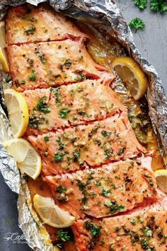 Cafe Delights says to bake your salmon with honey and garlic in foil. You can add butter for extra flavor.