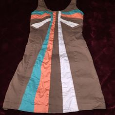 Judith March mini dress This is an adorable dress from Judith March.. It has gorgeous colors that are gorgeous with darker skin.. It didn't look right on me.. The colors are very vibrant, plain brown on back .. Fully lined.. Great condition Judith March Dresses Mini