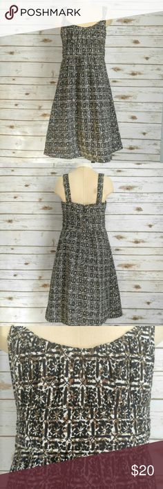 New York & Company Patterned Dress New York & Company Black tan and brown patterned dress Size 4 100% cotton. Mid length, perfect for a warm summer day. Check out the rest of my closet for cardigan cover ups! New York & Company Dresses Midi