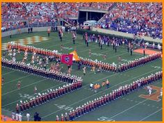 """Running thru the T - The University of Tennessee Volunteers football team starts the traditional """"Run through the T"""" before a crowd of over 100,000 people to start off an exciting afternoon of Volunteer football."""