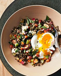 Warm Lentil Salad with Poached Eggs Recipe | Martha Stewart Living — French green lentils and Swiss chard join the aromatic blend of finely diced onion, carrot, and celery known as mirepoix in this hearty salad.