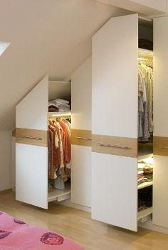 Wardrobe underneath pitched roof - using apothecary drawers - great idea for our master bedroom closet