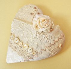 (::)  Lovely heart with vintage fabric, lace and buttons. Maybe a pincushion? Or ring bearer's pillow?  <3