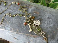 Typewriter Key Jewelry - Asymmetrical Antique Brass Leaves, Skeleton Key and Initial C Typewriter - by Etsy's thekeyofa #handmade #jewelry #jewellery