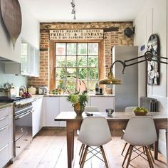 Looking for some kitchen inspiration on Pinterest and I found this ✨✨✨#brickwall #woodfloors #lightinglove makes me happy dance Pinterest • • • • • #kitchendecor #rustickitchen #rusticmodern #eclecticdecor #designdetails #decorideas #interiordetails #modernrustic #kitchengoals #kitchenlove #founditems #thriftedstyle #homedecorideas #homestylinginspo #kitchenideas #interiorstyled #interiorforinspo #homedeta